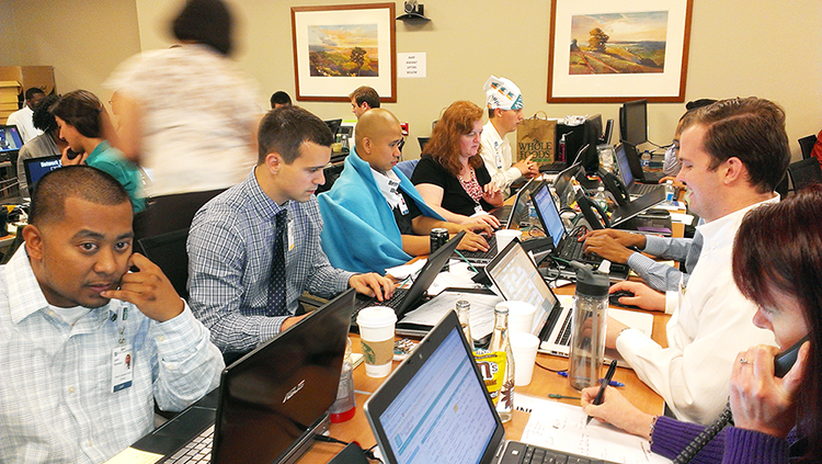 People working on computers at Summerland Education | Healthcare IT Technology Transformation Leader